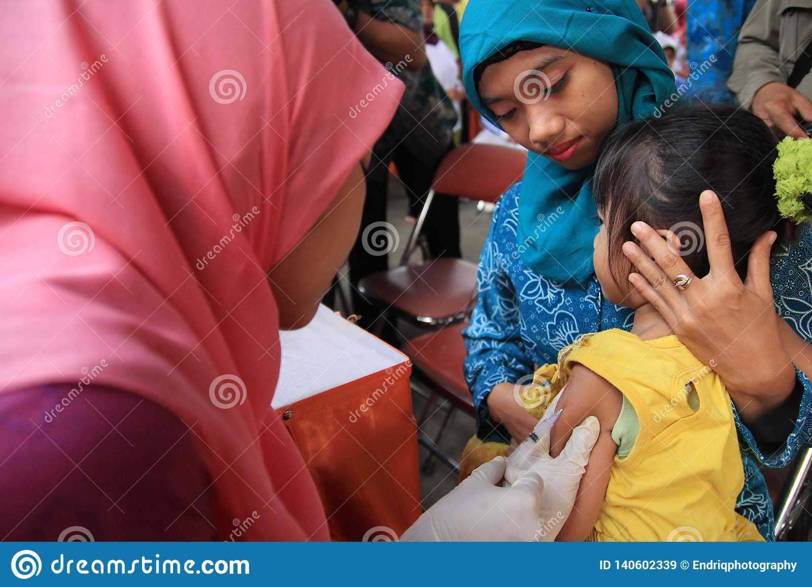 Surabaya indonesia, may 21, 2014. a health worker gave vaccinations to children