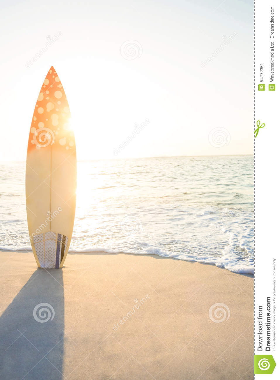 surf board standing on the sand