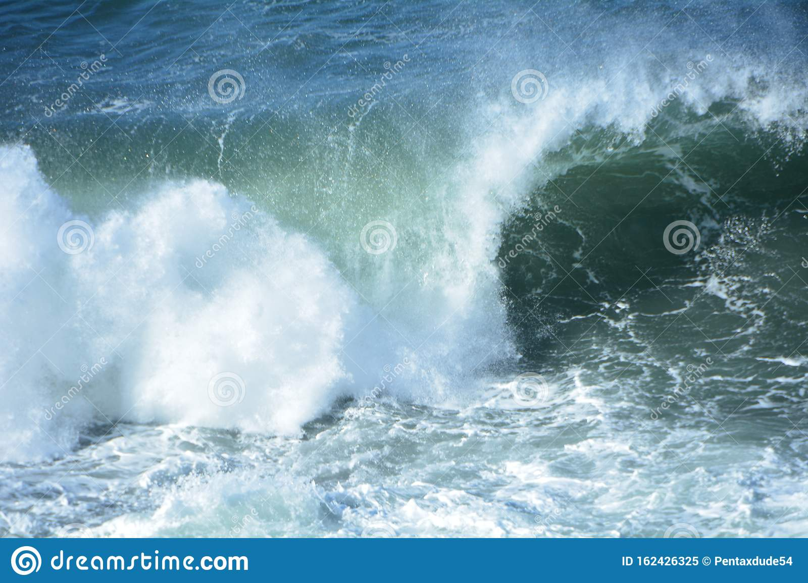 A wave crashes at Shore Acres State Park on the Oregon Coast