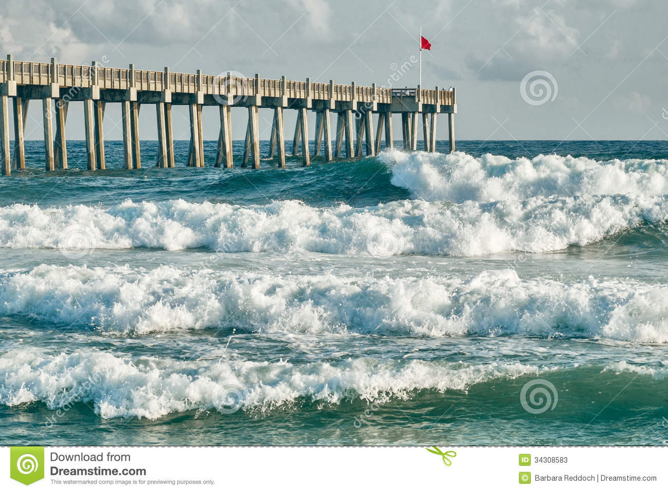 Surf 39 s up pensacola beach fishing pier stock photos for Tides for fishing pensacola