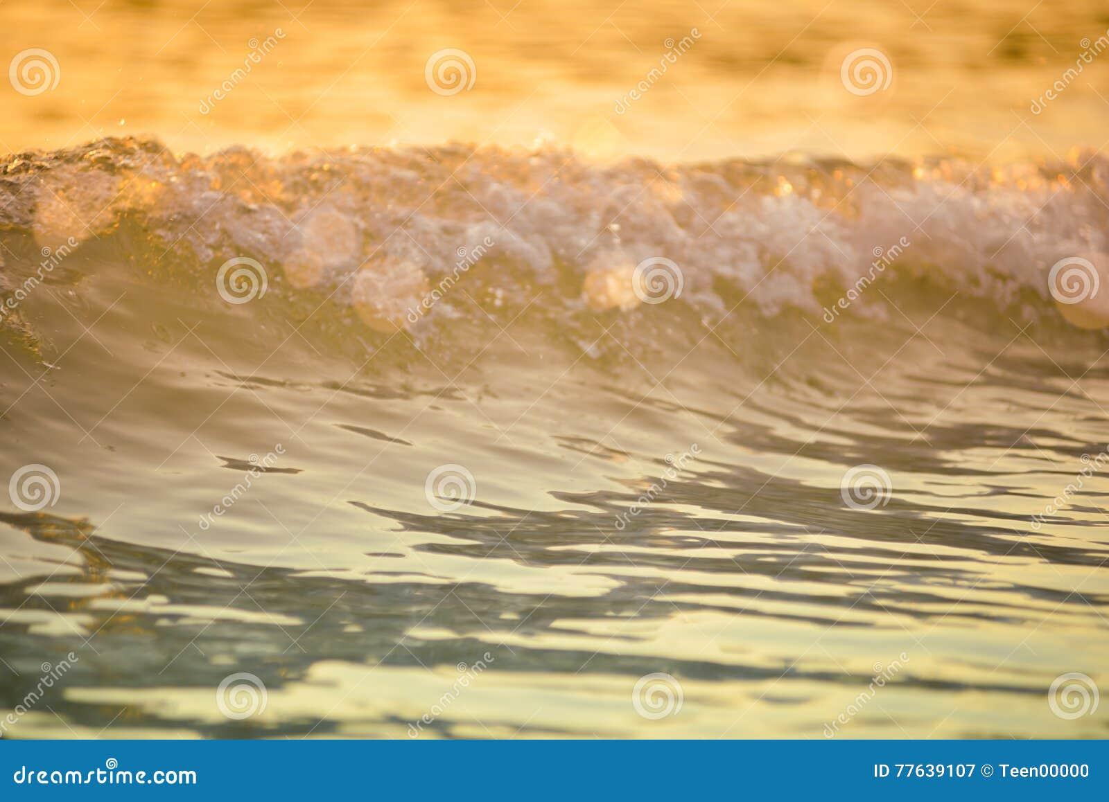 surf sea blured wave at golden light sunset beach background de