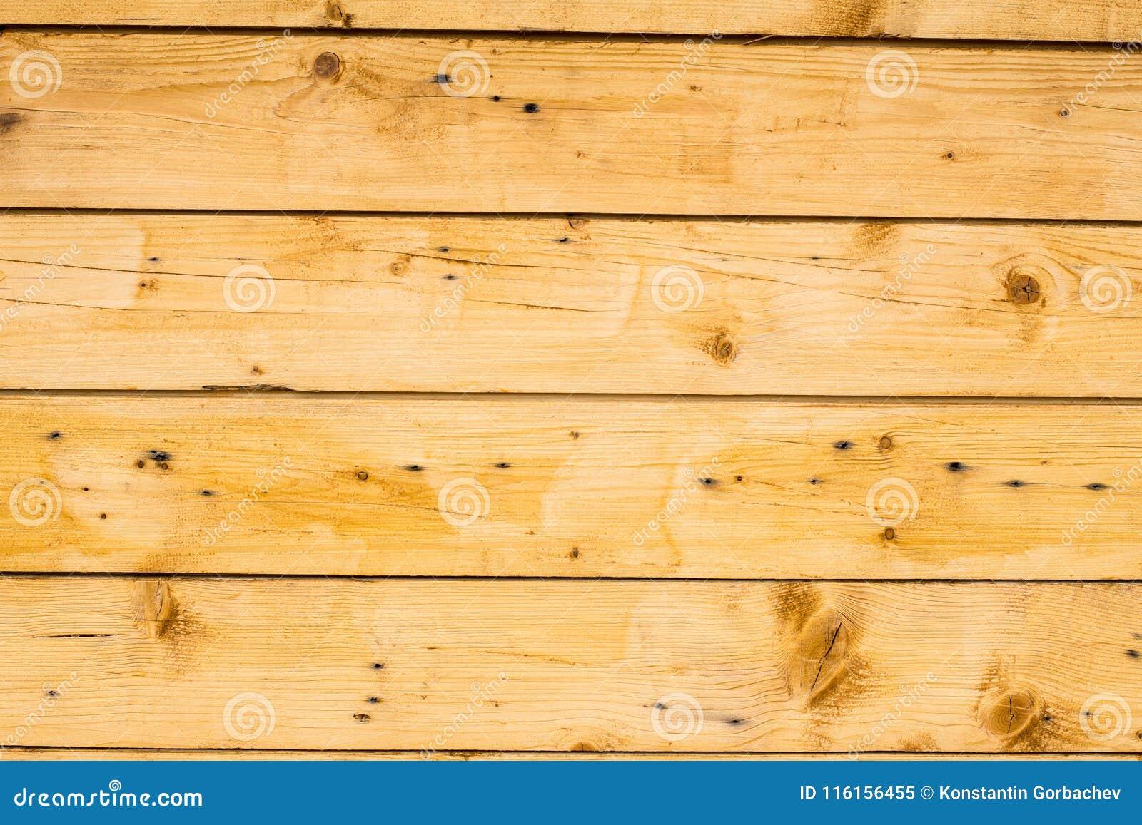 La Plinthe Du Mur surface en bois brun clair de planches, de mur, de table, de