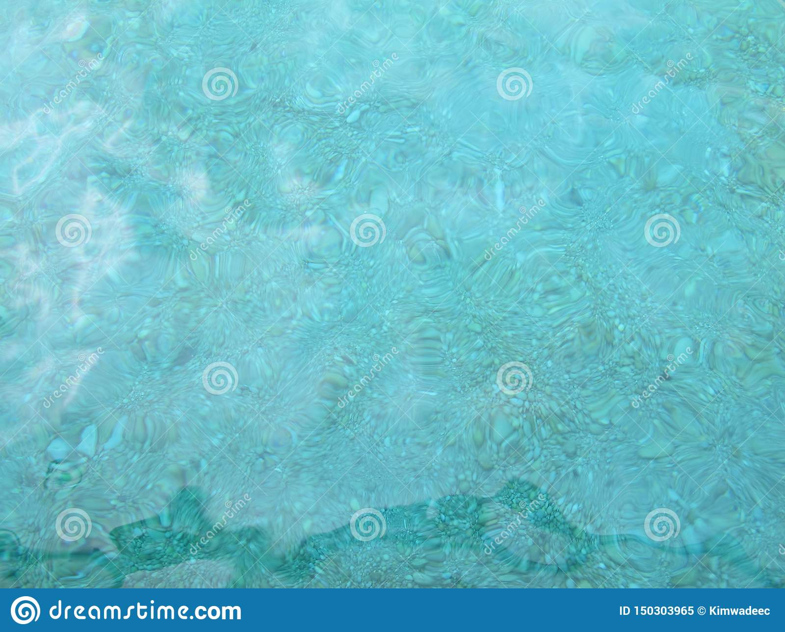 Transparent sea surface and rock bottom
