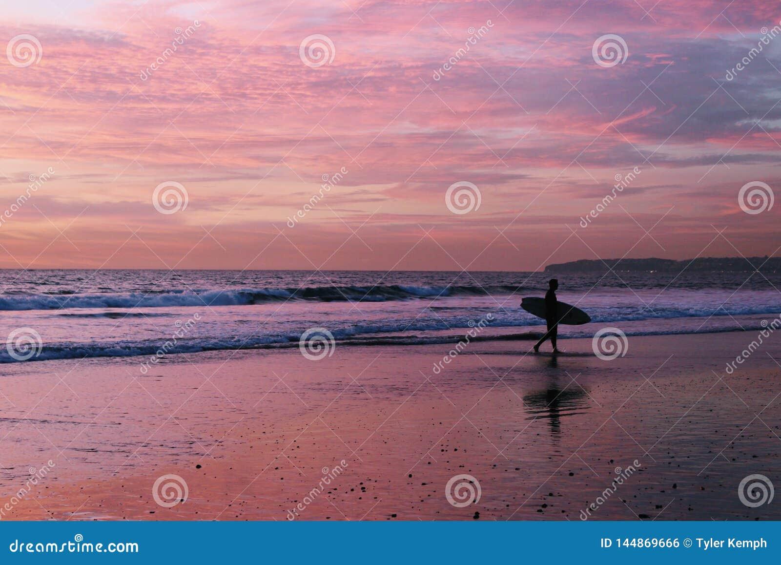Surfare p? stranden