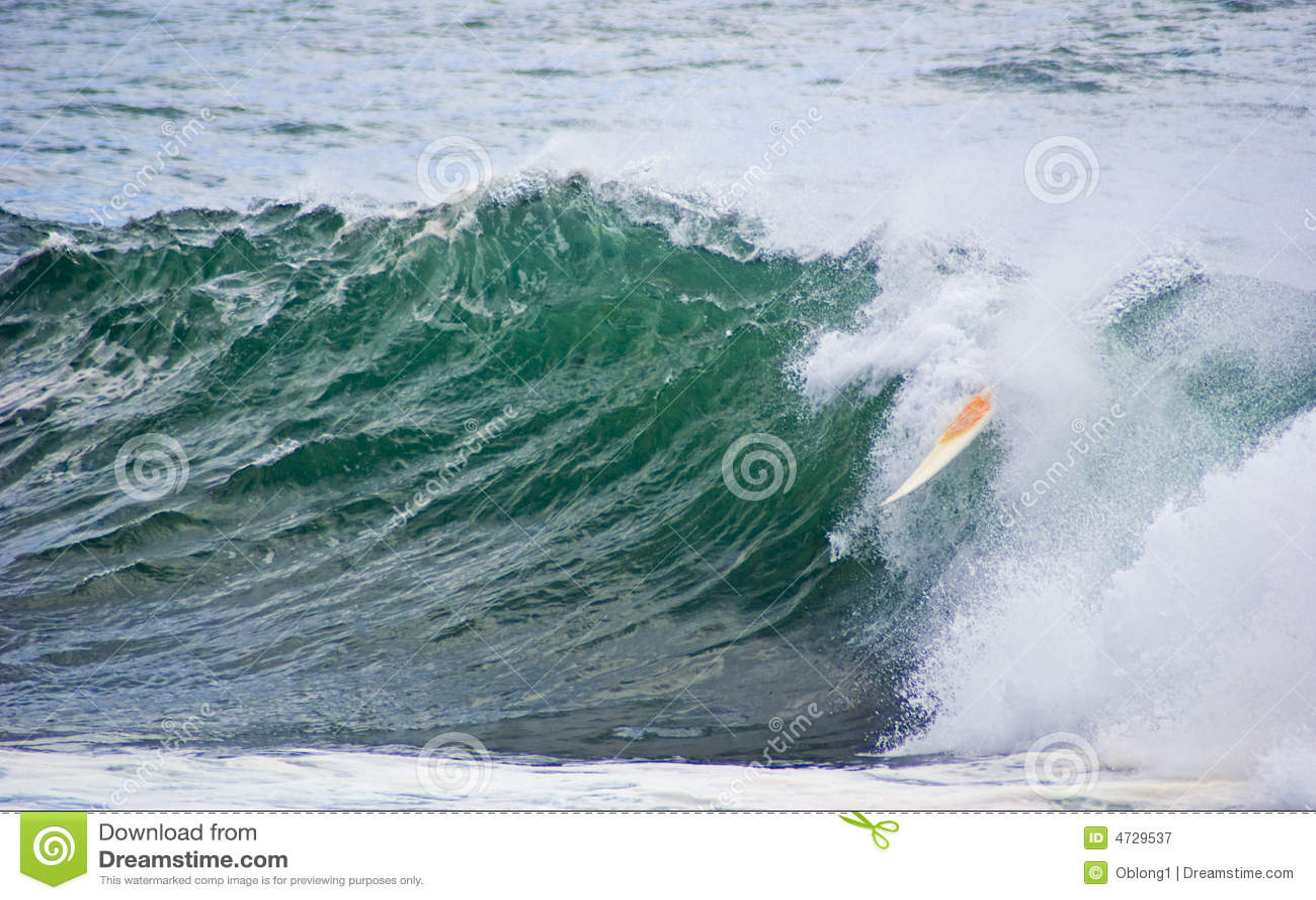 Surfboard dumped surf wave