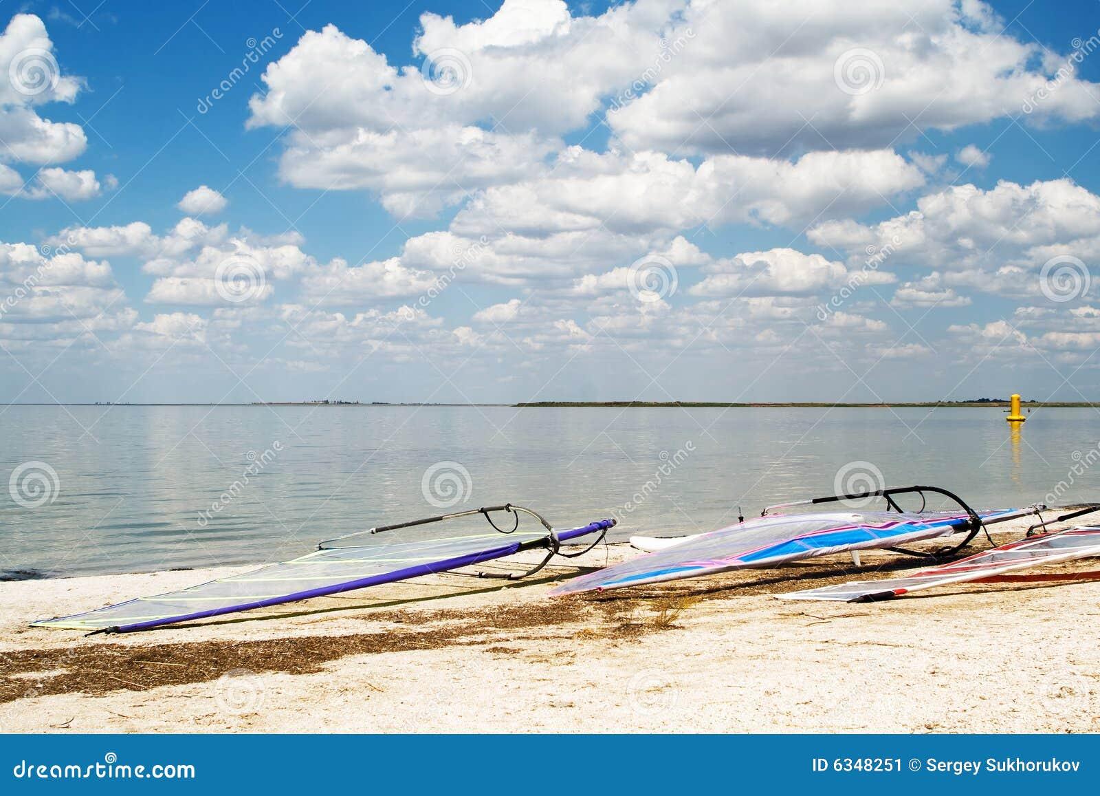 Surfboards on a beach a sea bay