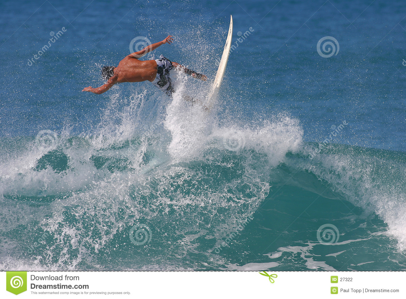 Surfer Catching Air While Surfing in Hawaii