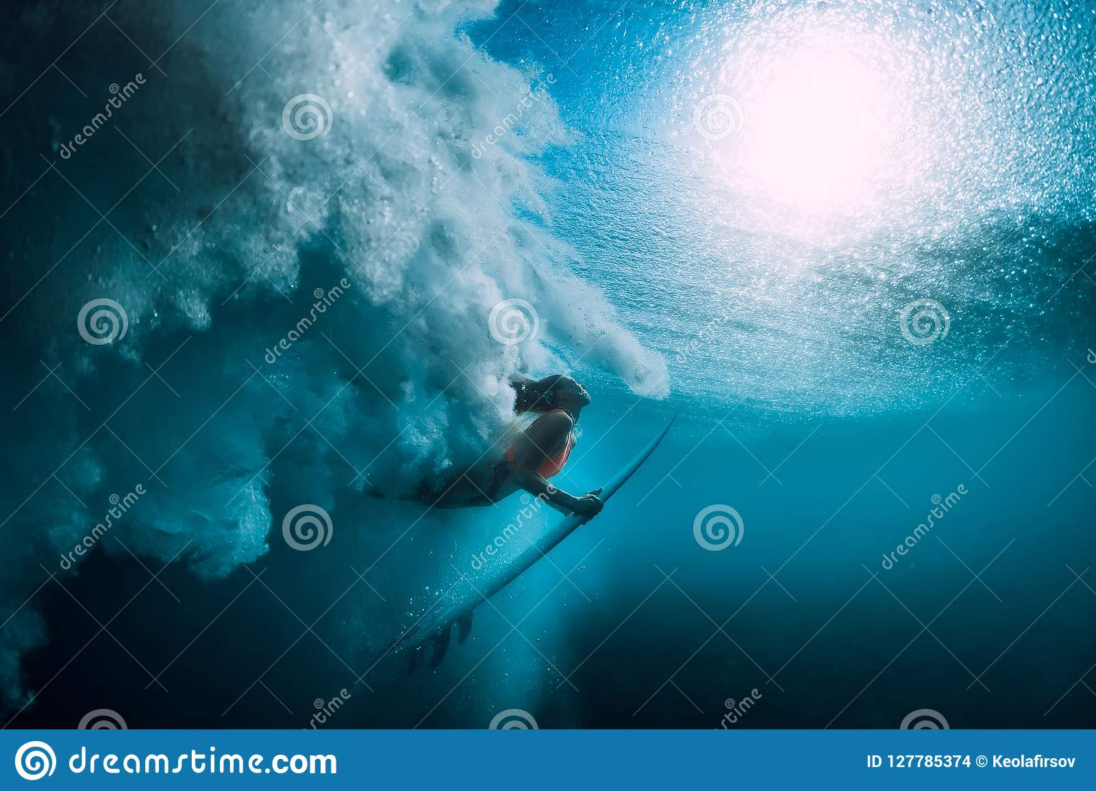 3f66396039 Surfer Girl With Surfboard Dive Underwater With Under Big Ocean Wave ...