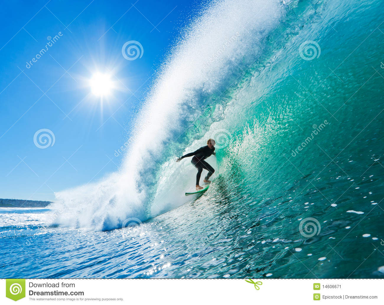 Surfer on Perfect Wave Getting Barreled