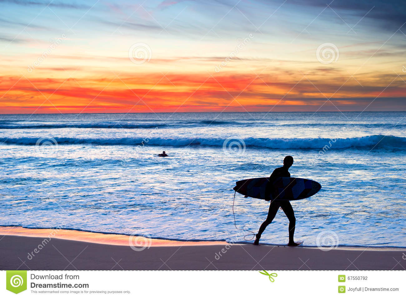 02bd1473bb Silhouette of a surfer on the beach at a beautiful sunset