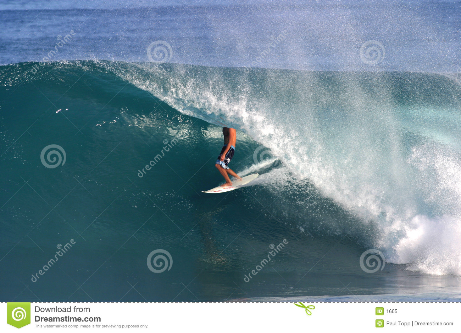 Surfer Surfing Backdoor Pipeline in Hawaii