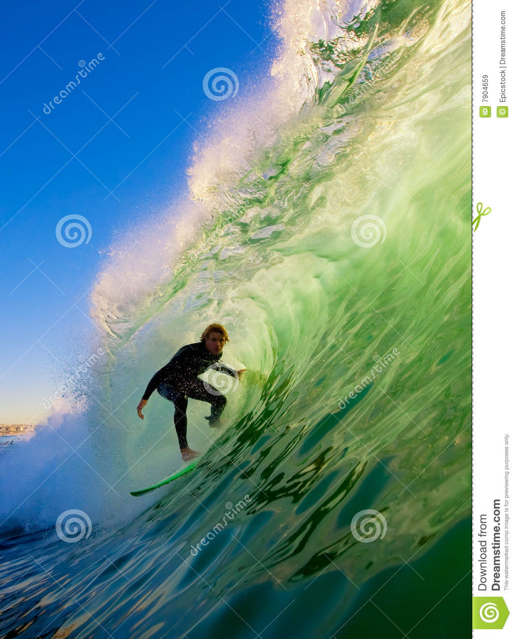 Surfer In The Tube Riding A Big Wave