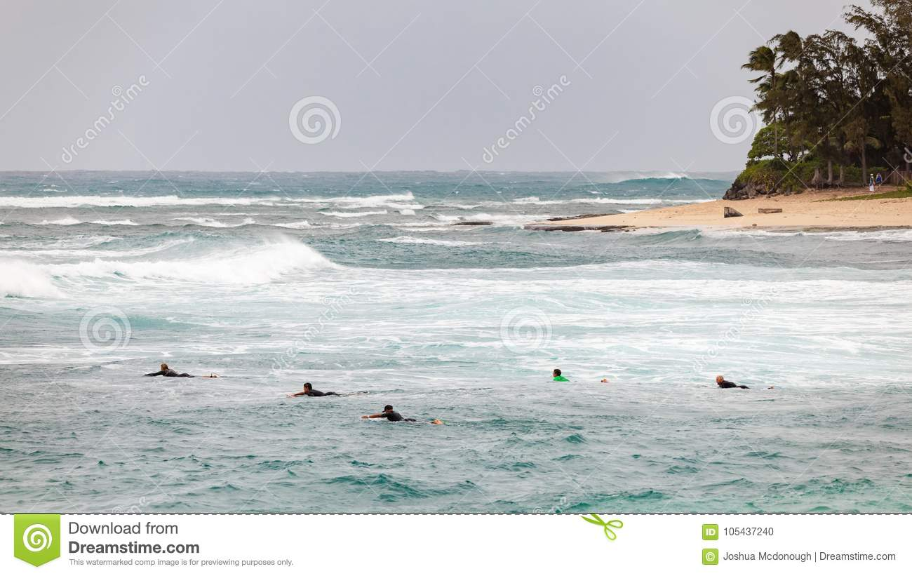d282cc872bd14a Surfers Paddling Out To Waves Sunset Beach Hawaii Editorial Image ...