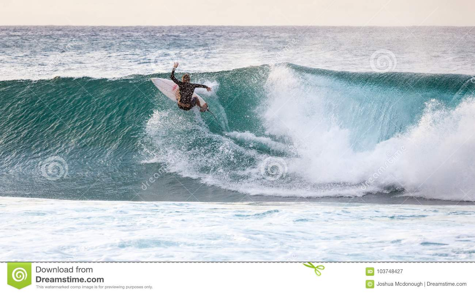 e73b0a5e92 Surfing on the Banzai Pipeline wave break on Oahu North Shore in Hawaii