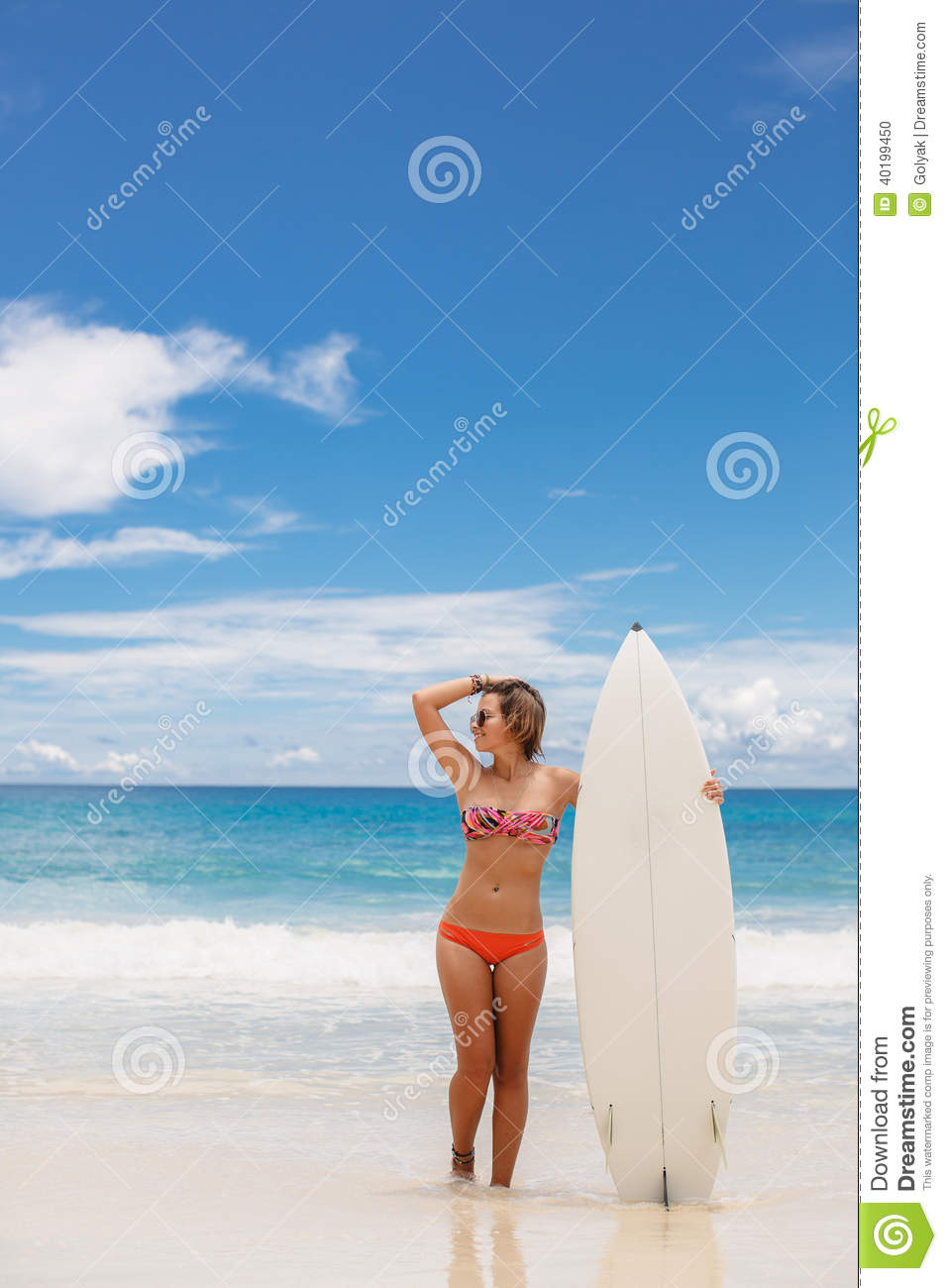 Surfing beautiful woman on the beach