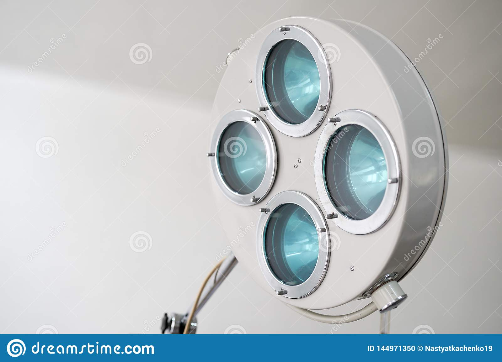 Surgical lamp and medical devices in the operating room. Background