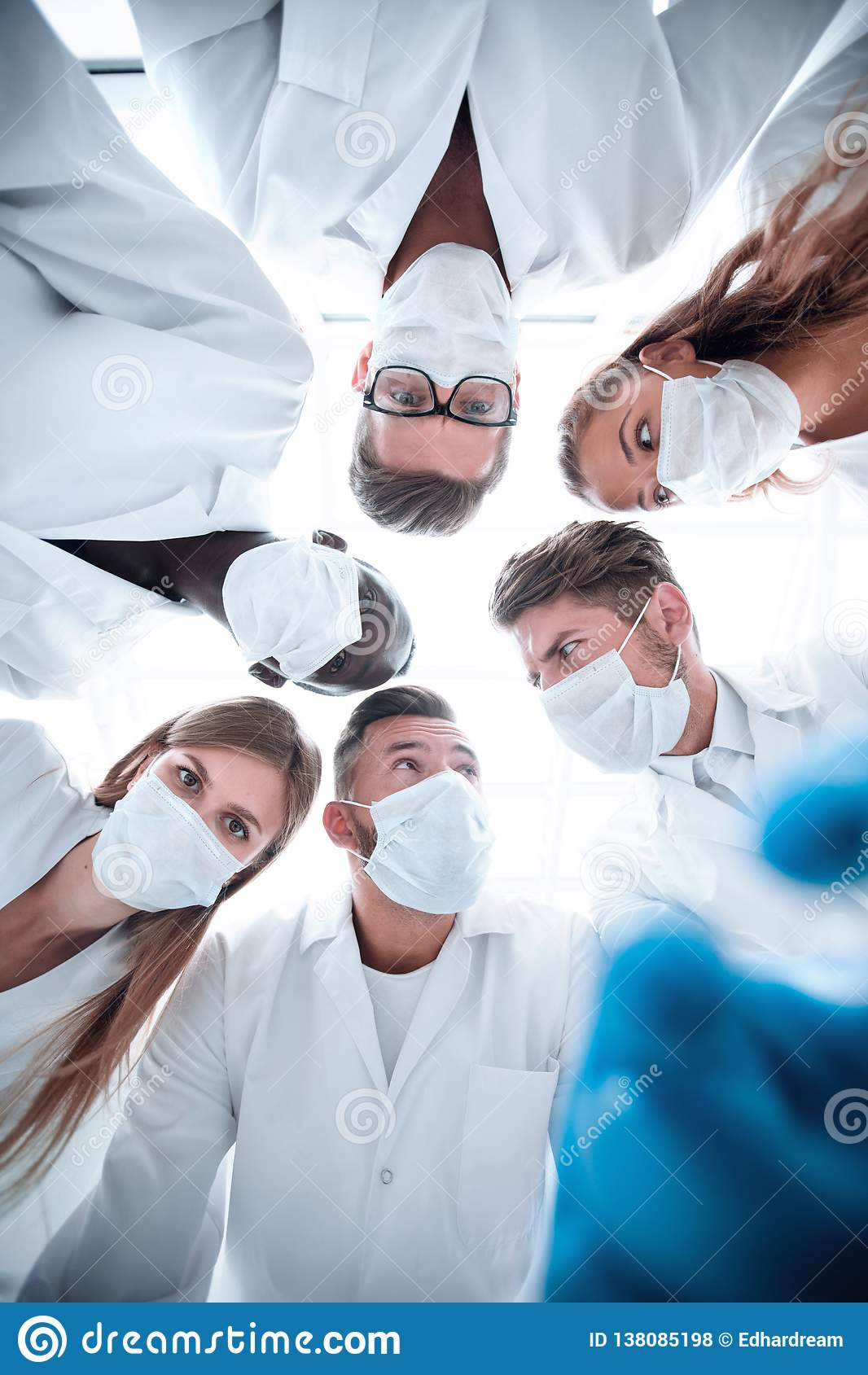 Surgeons looking down patient hospital