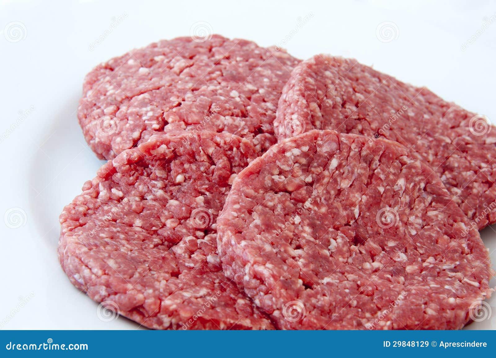 Surowi wołowina hamburgery
