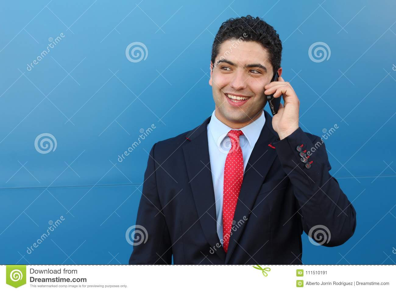Surprised businessman getting great news on the phone