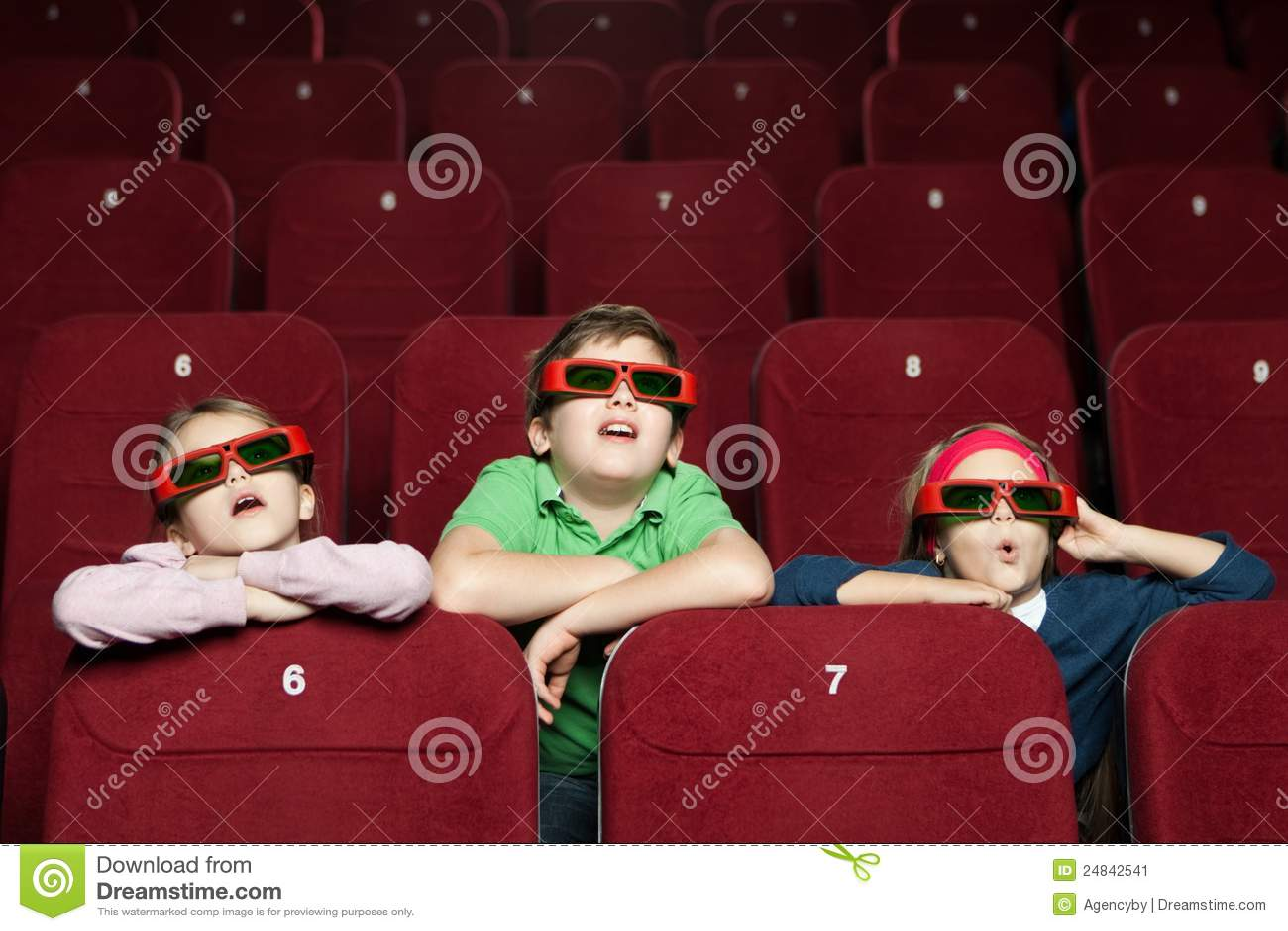 Surprised children at the cinema