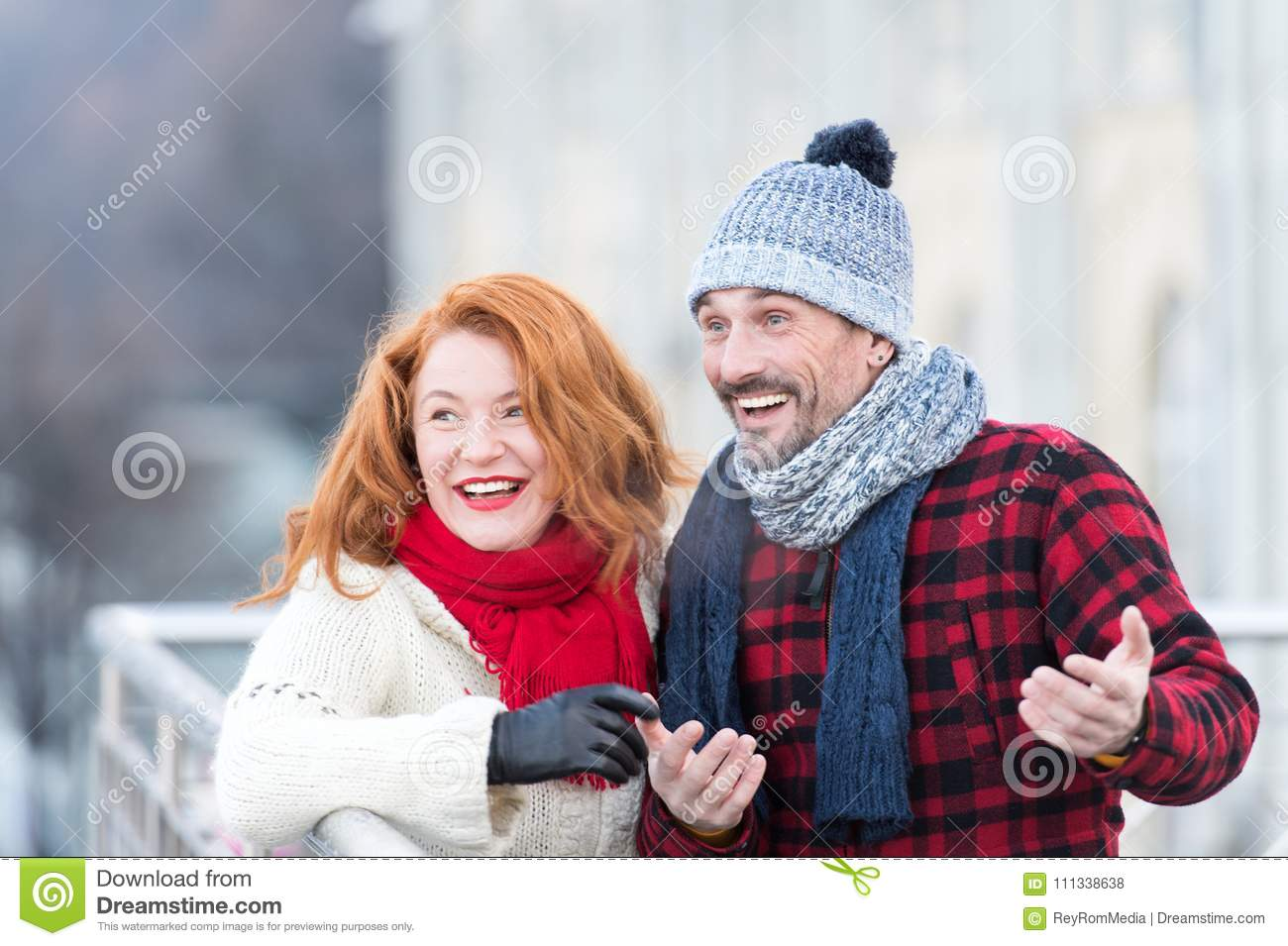 Surprised couple in the city. Surprised funny men with woman. Urban guy and lady have fun on meeting. Aged family wondered to city
