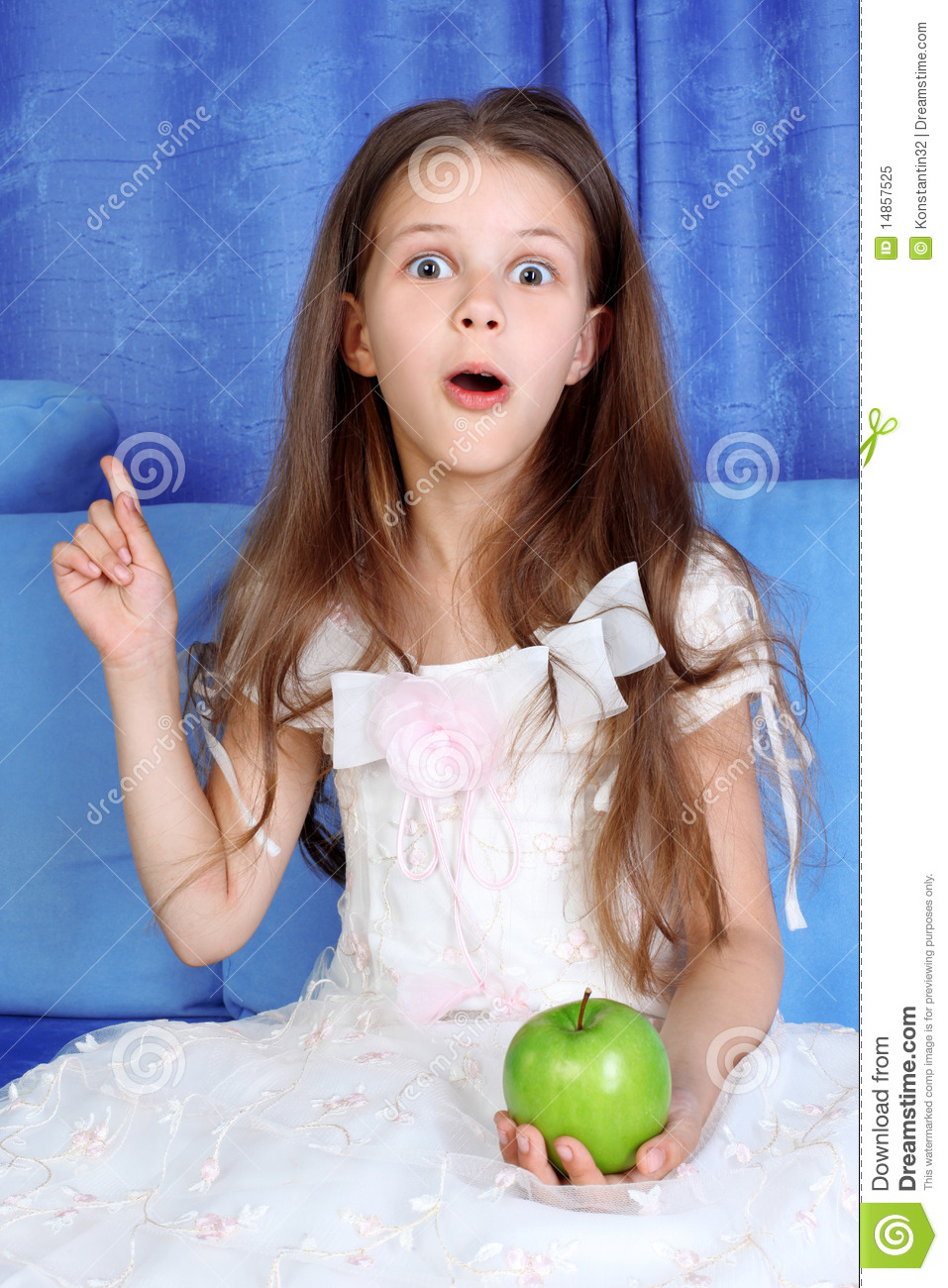 Surprised girl with apple