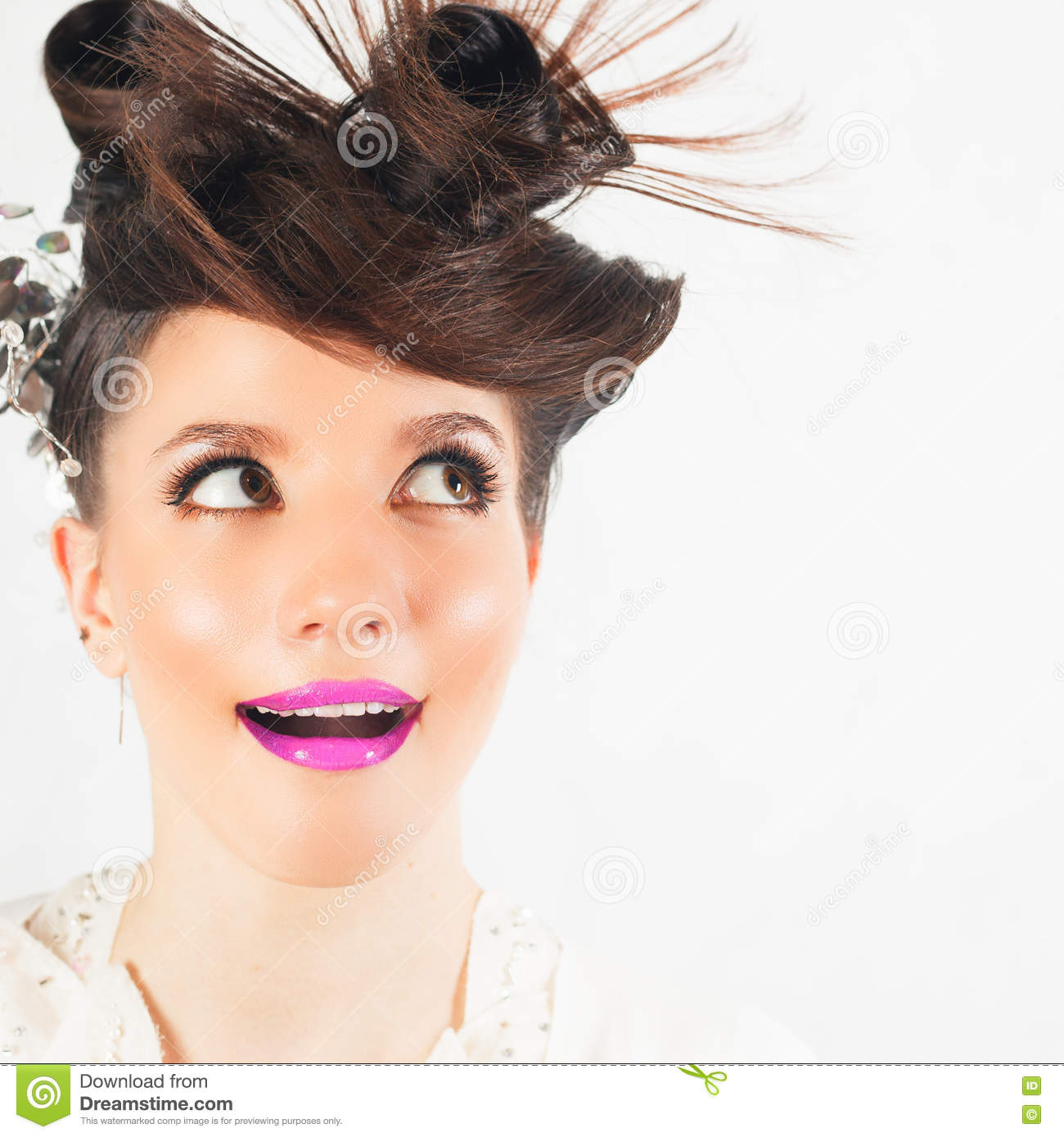 Surprised Girl With Fancy Hairstyle At White Background Stock Image