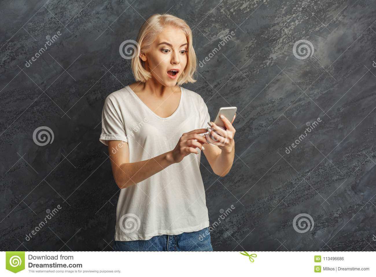 Good Background Reading For Seeing >> Surprised Girl Reading Good News On Mobile Stock Photo Image Of
