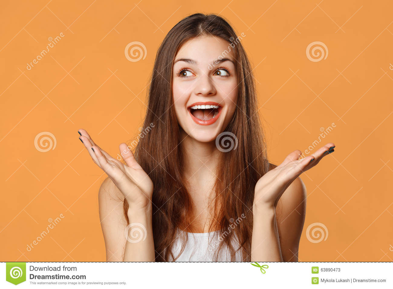 Download Surprised Happy Beautiful Woman Looking Sideways In Excitement. Isolated On Orange Background Stock Image - Image of european, expression: 63890473