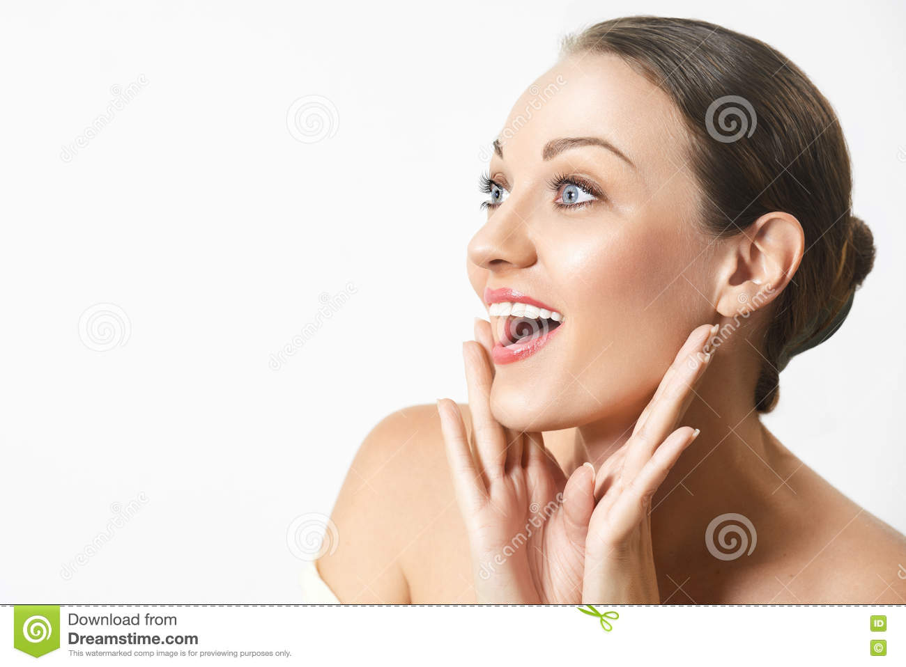 Surprised happy young woman looking sideways in excitement.
