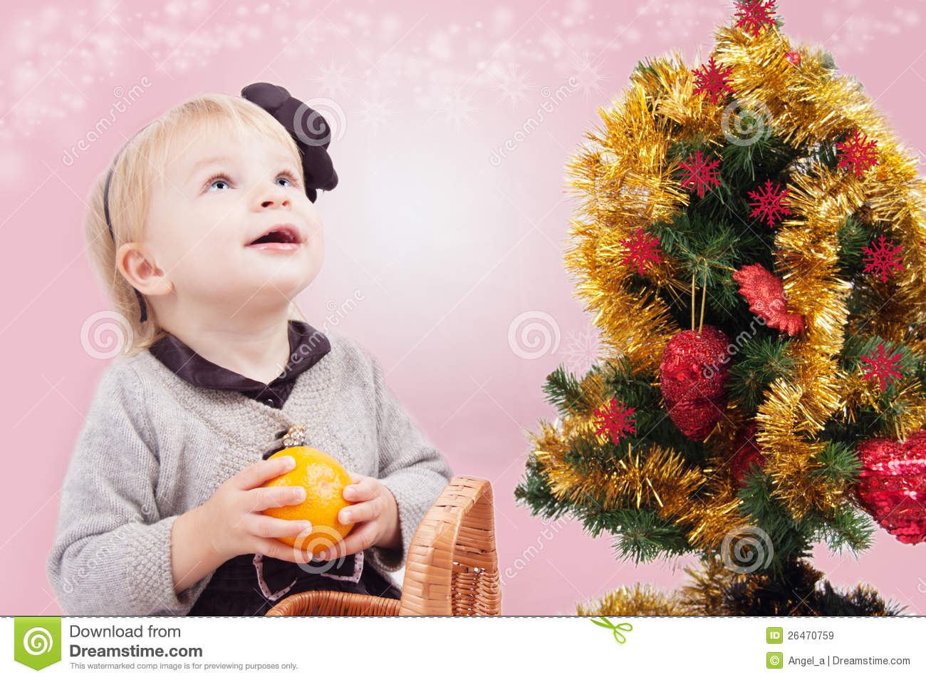 Surprised Little Girl Under Christmas Tree Royalty Free