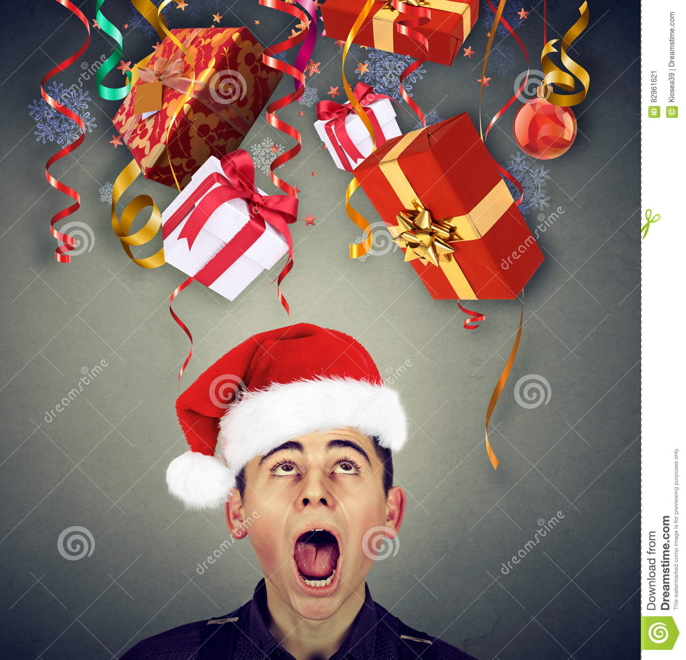 Surprised Man In Santa Claus Hat Looking Up At Christmas Gifts Stock ...