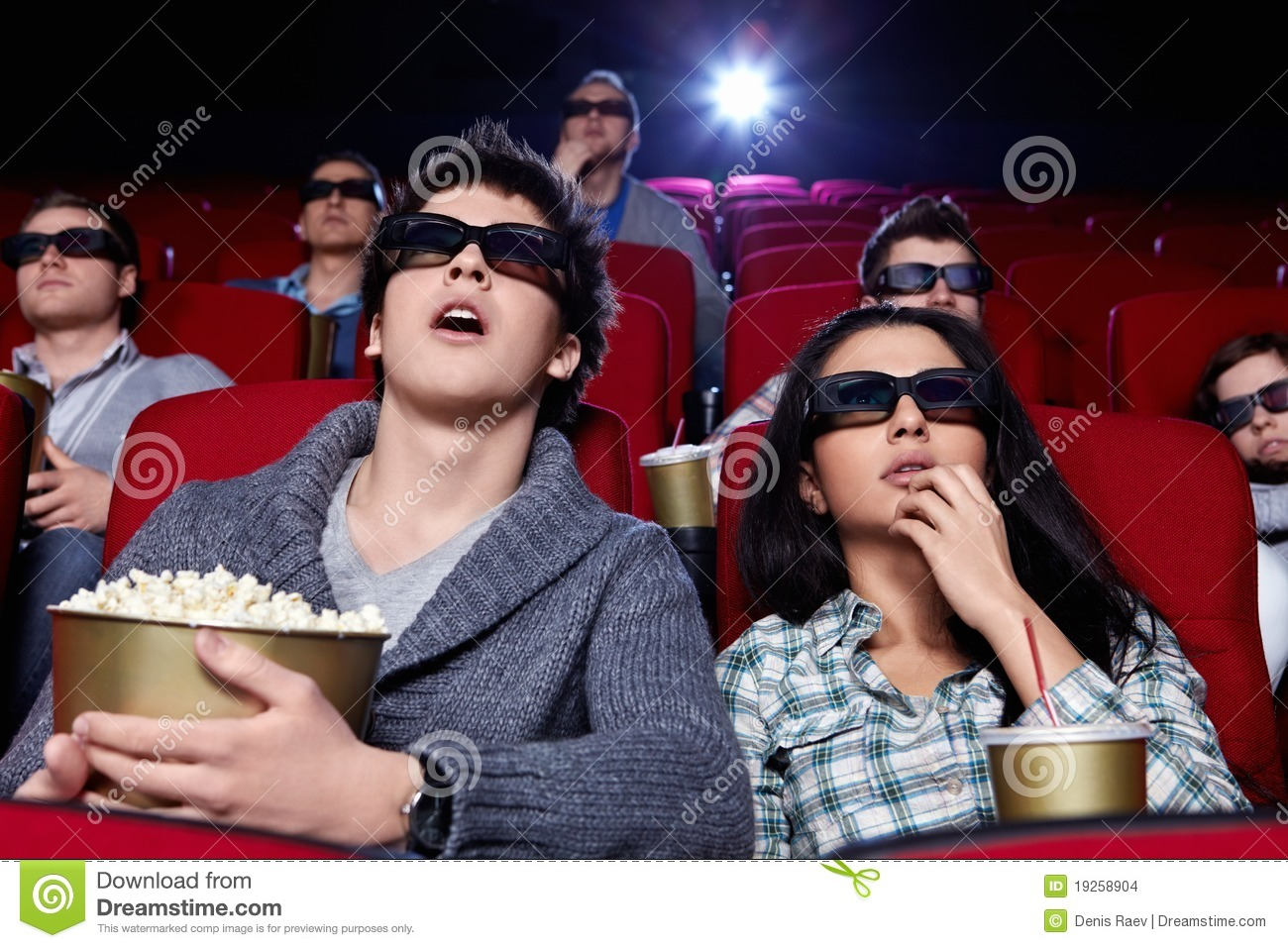 Surprised people are watching a movie stock photo image for People watching