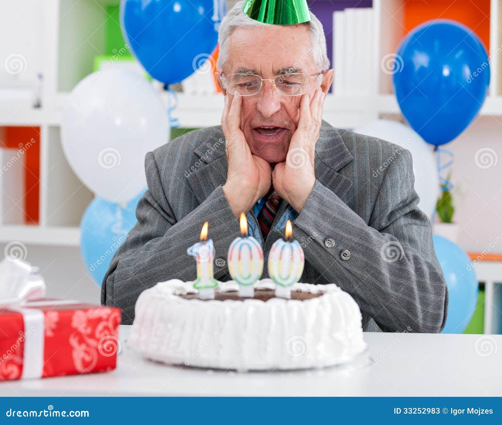 Surprised Senior Man Looking At Birthday Cake Stock Image Image Of