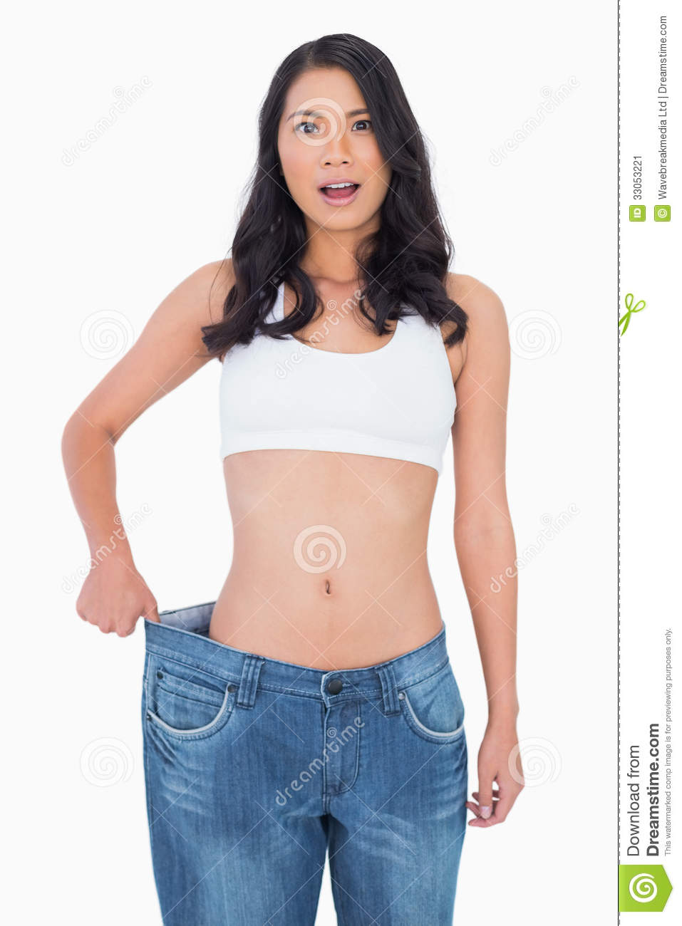 Background image too big - Surprised Woman Wearing Too Big Jeans Stock Image