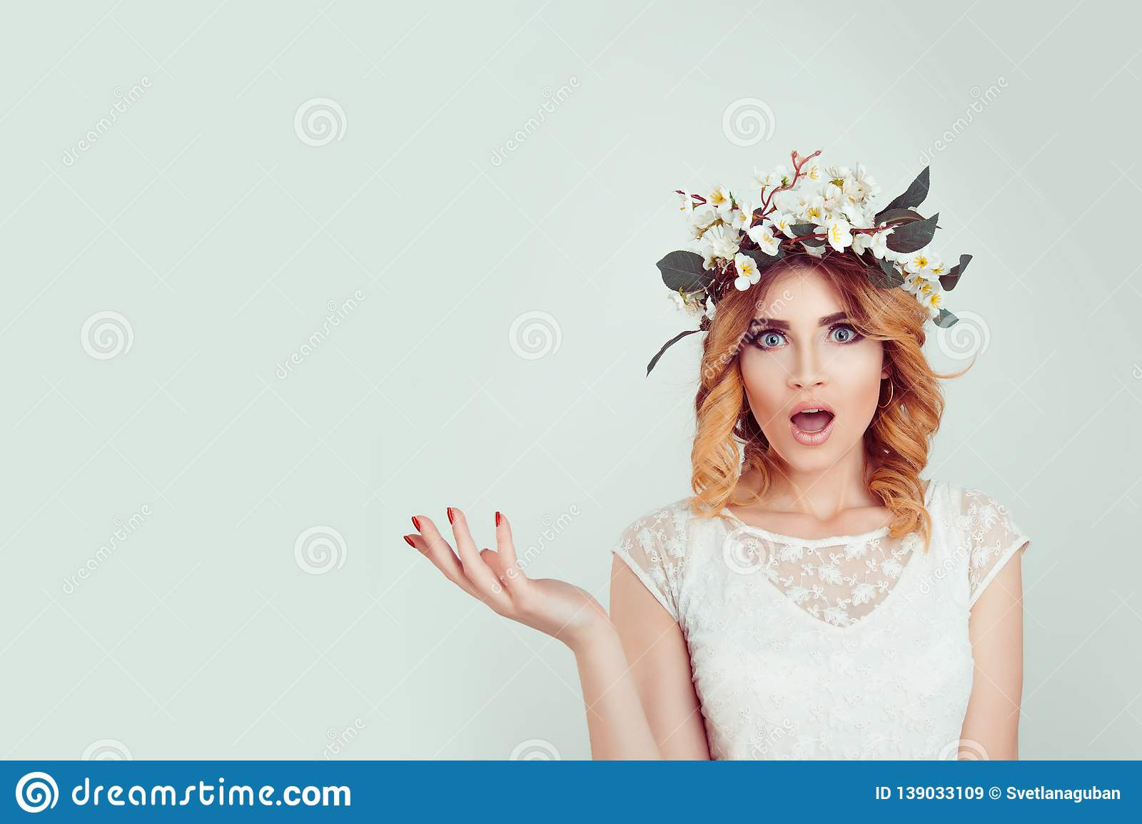 Surprised stunned woman in floral headband portrait