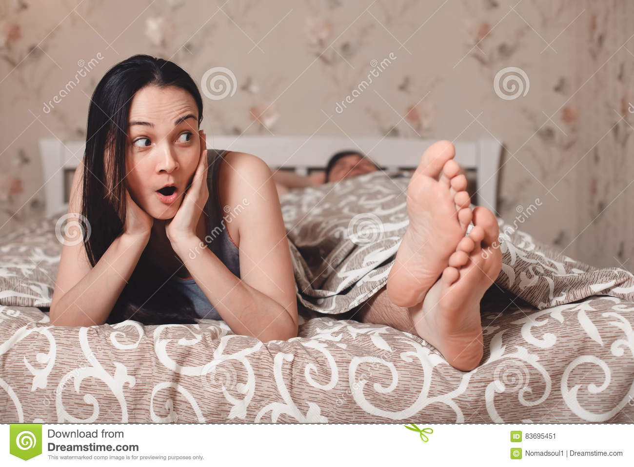 Men And Women In Bedroom Surprised Woman With Her Man Lying In Bed Stock Photo Image