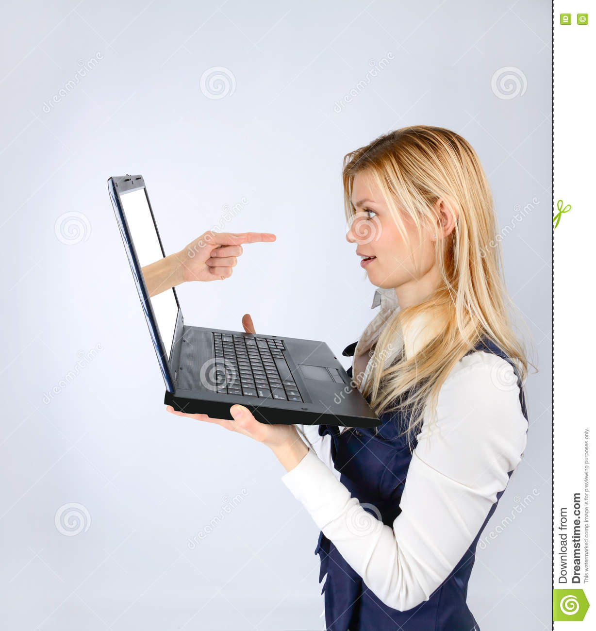 Surprised woman holding a laptop and hand