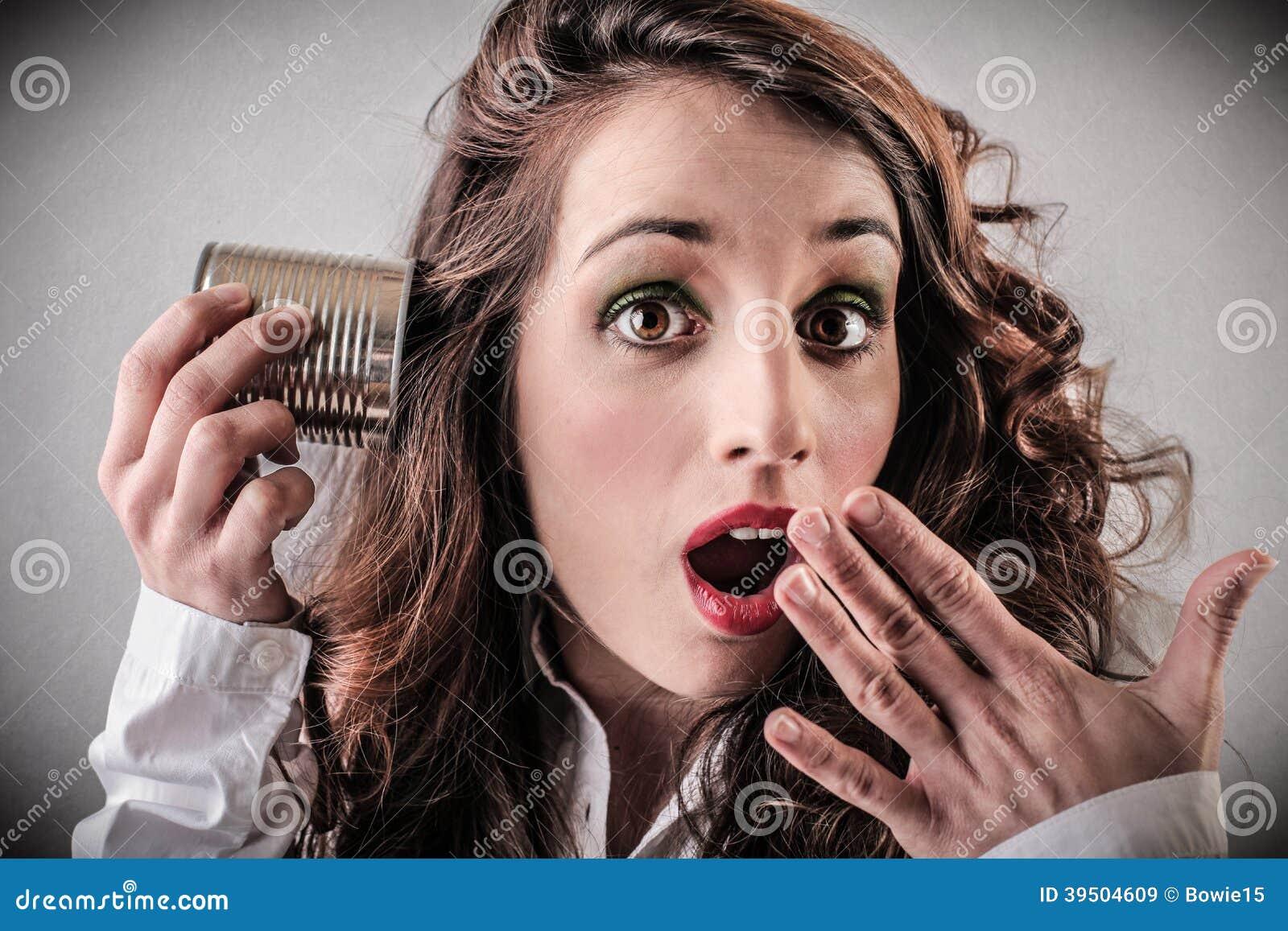 Surprised woman listening to something