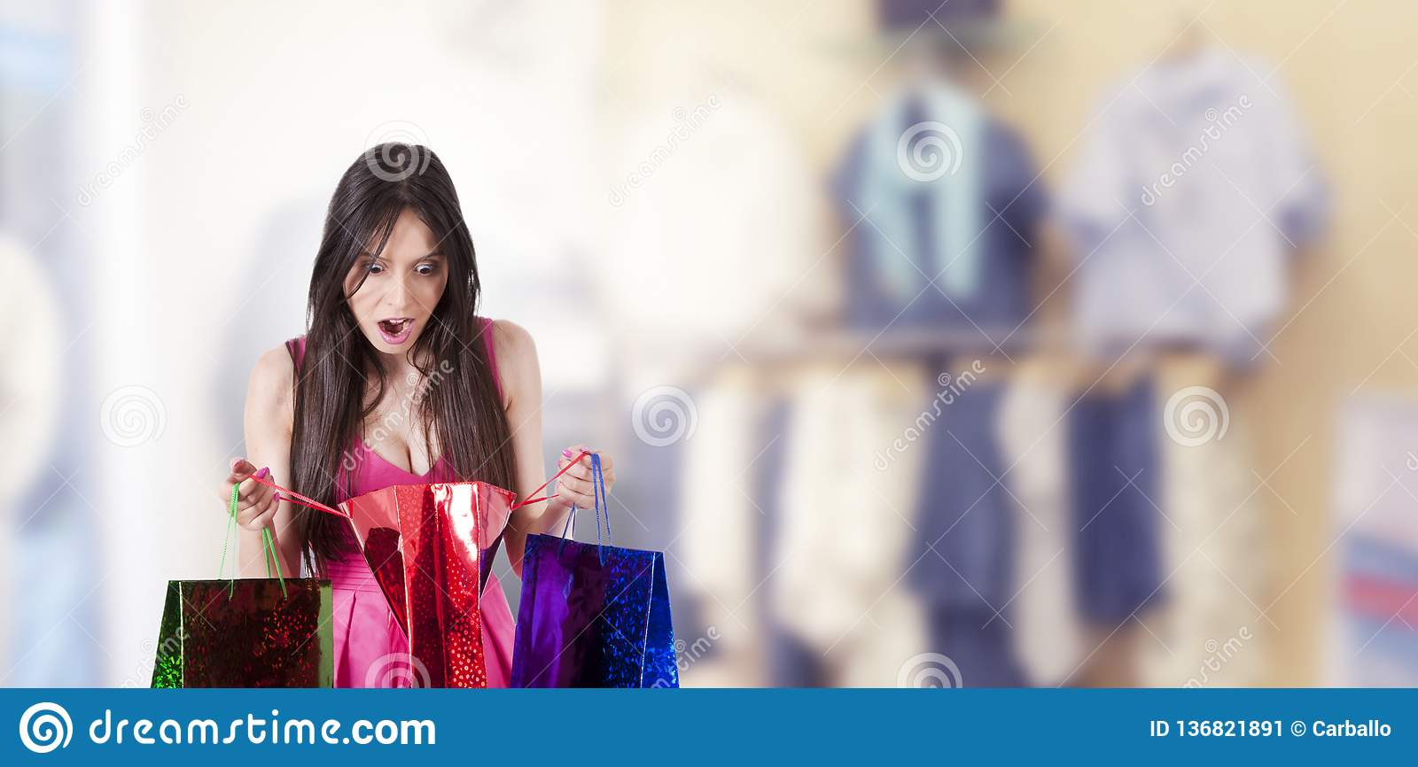 Surprised woman looking at shopping