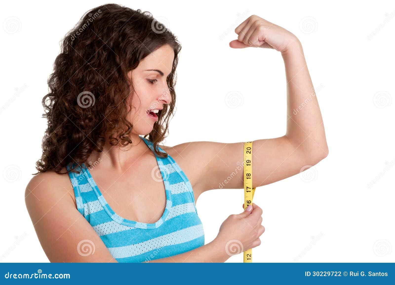 surprised woman measuring her biceps stock photography image 30229722. Black Bedroom Furniture Sets. Home Design Ideas