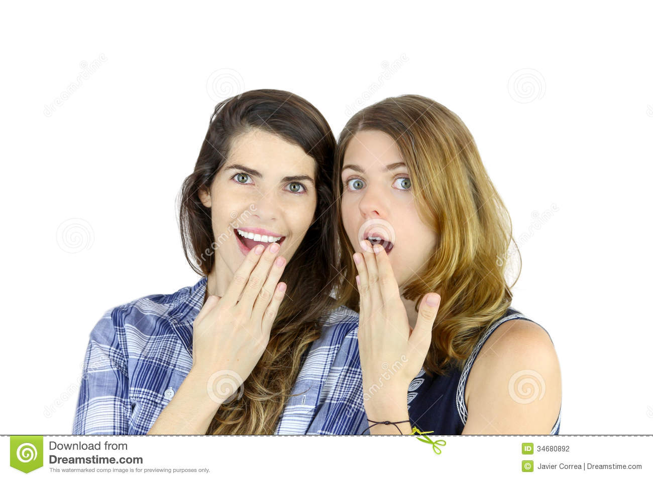 couple of young women looking at the camera with an expression of ...