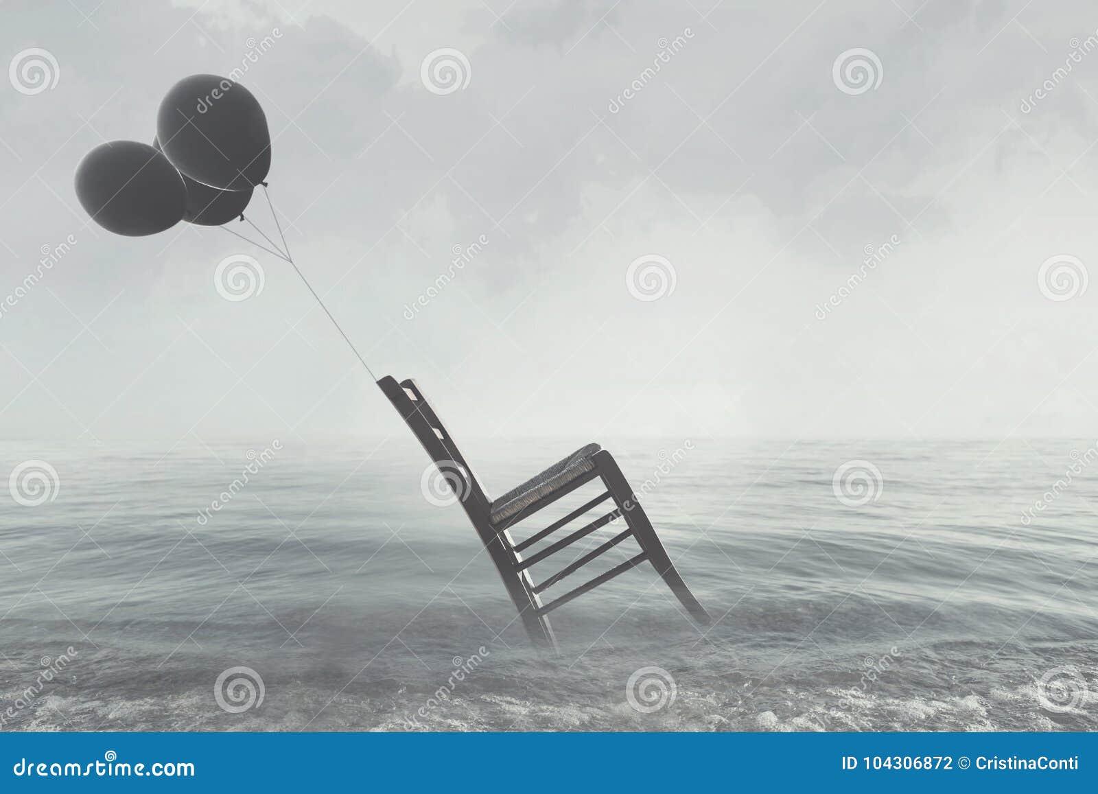 Surreal beeld van een stoel in evenwicht door vliegende zwarte ballons wordt gehouden die