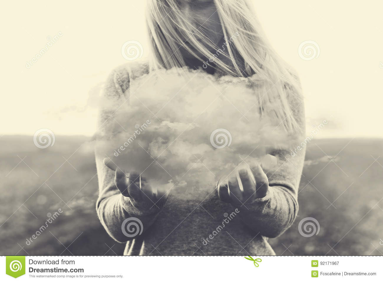 A surreal moment, solitary woman holding in her hands a grey cloud