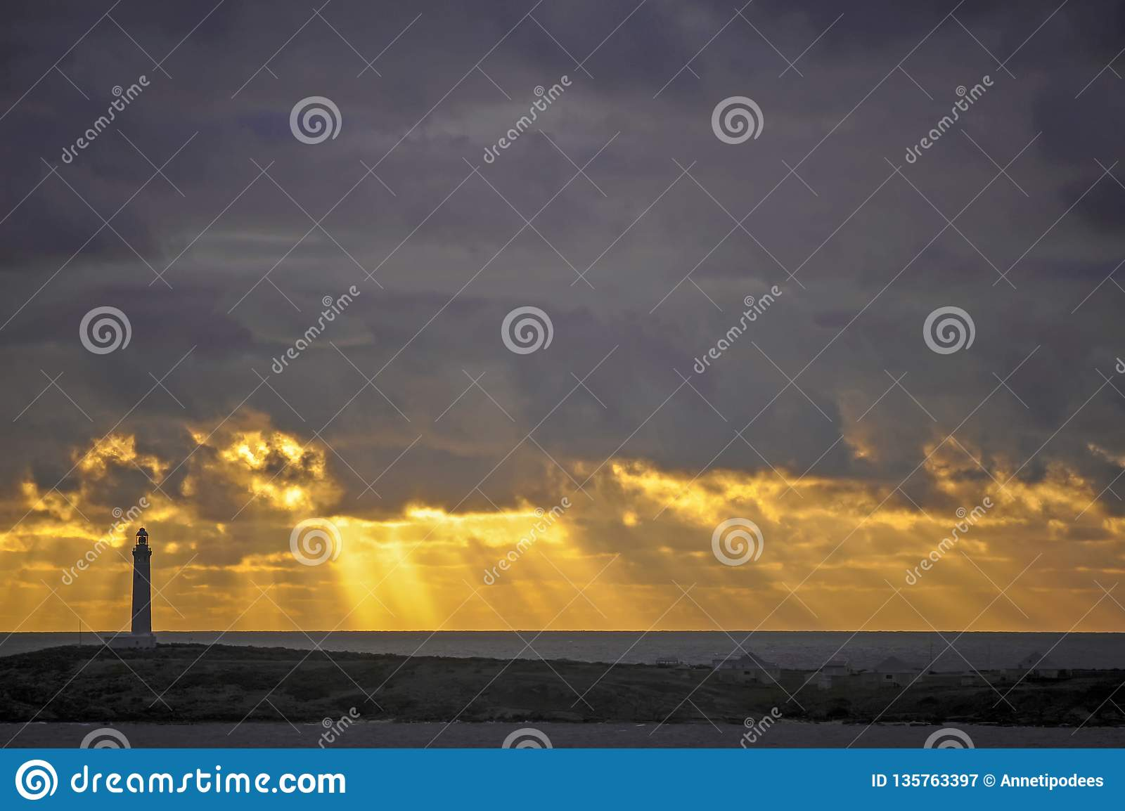 Surreal Yellow and Gray Sunset with a Light-house, Indian ocean and the great Southern Ocean.