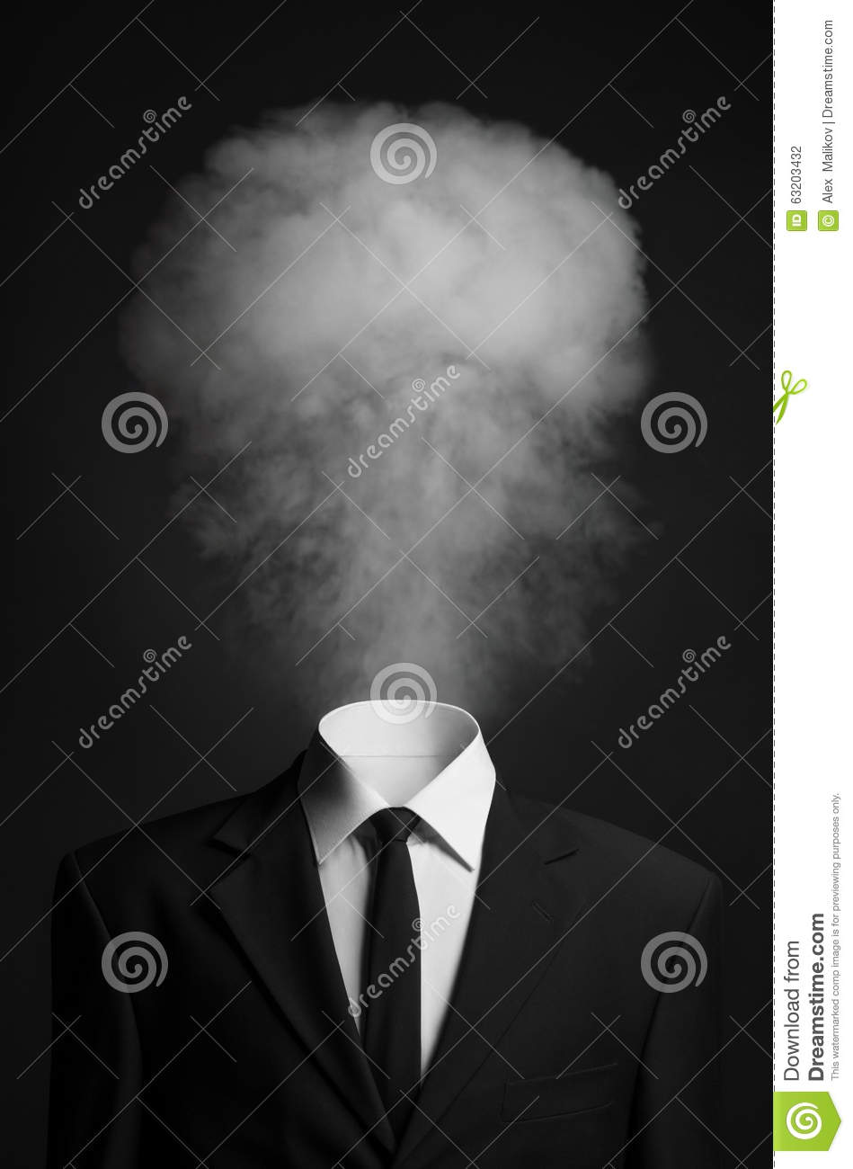 Surrealism and business topic: the smoke instead of a head man in a black suit on a dark background in the studio