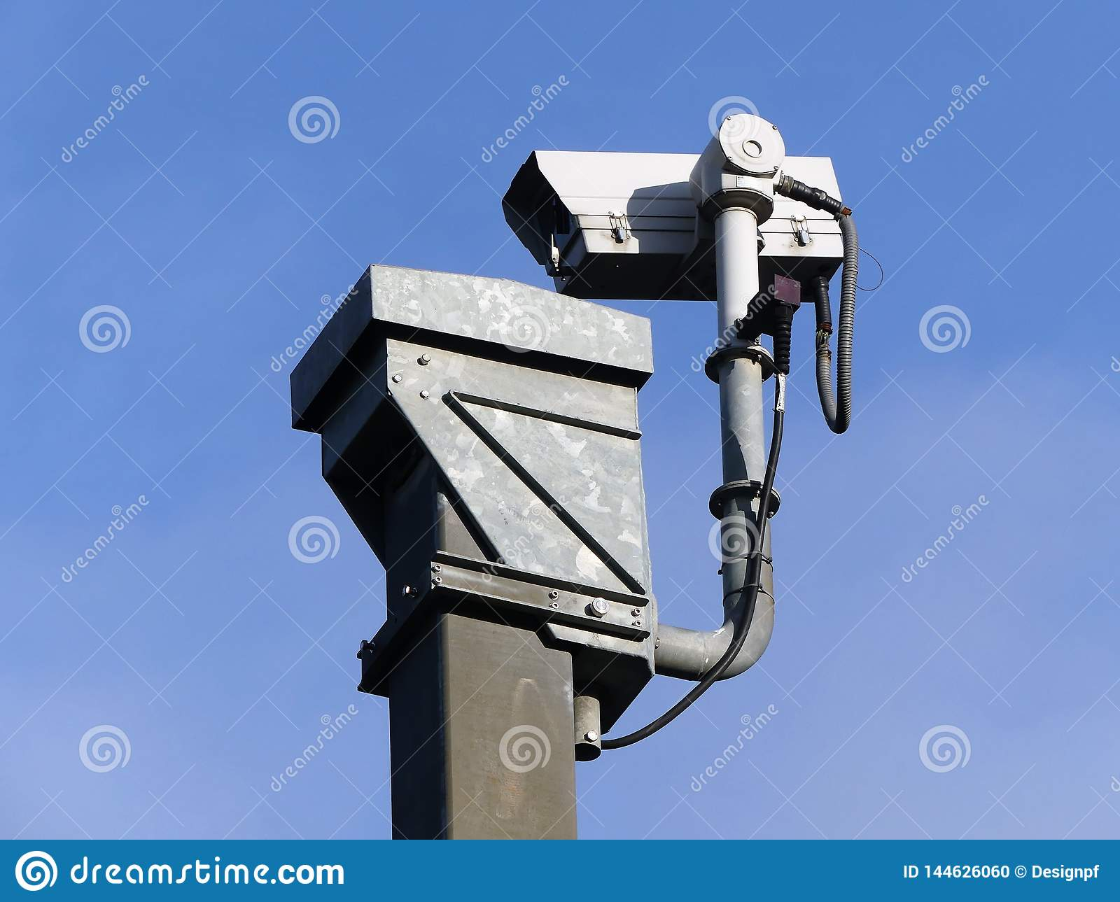 Surveillance camera monitoring motorway traffic on the M25