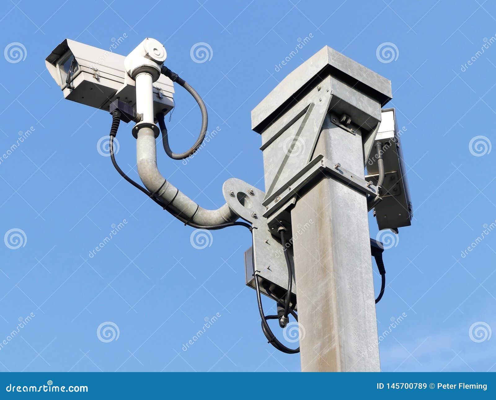 Surveillance cameras monitoring motorway traffic on the M25 in Hertfordshire