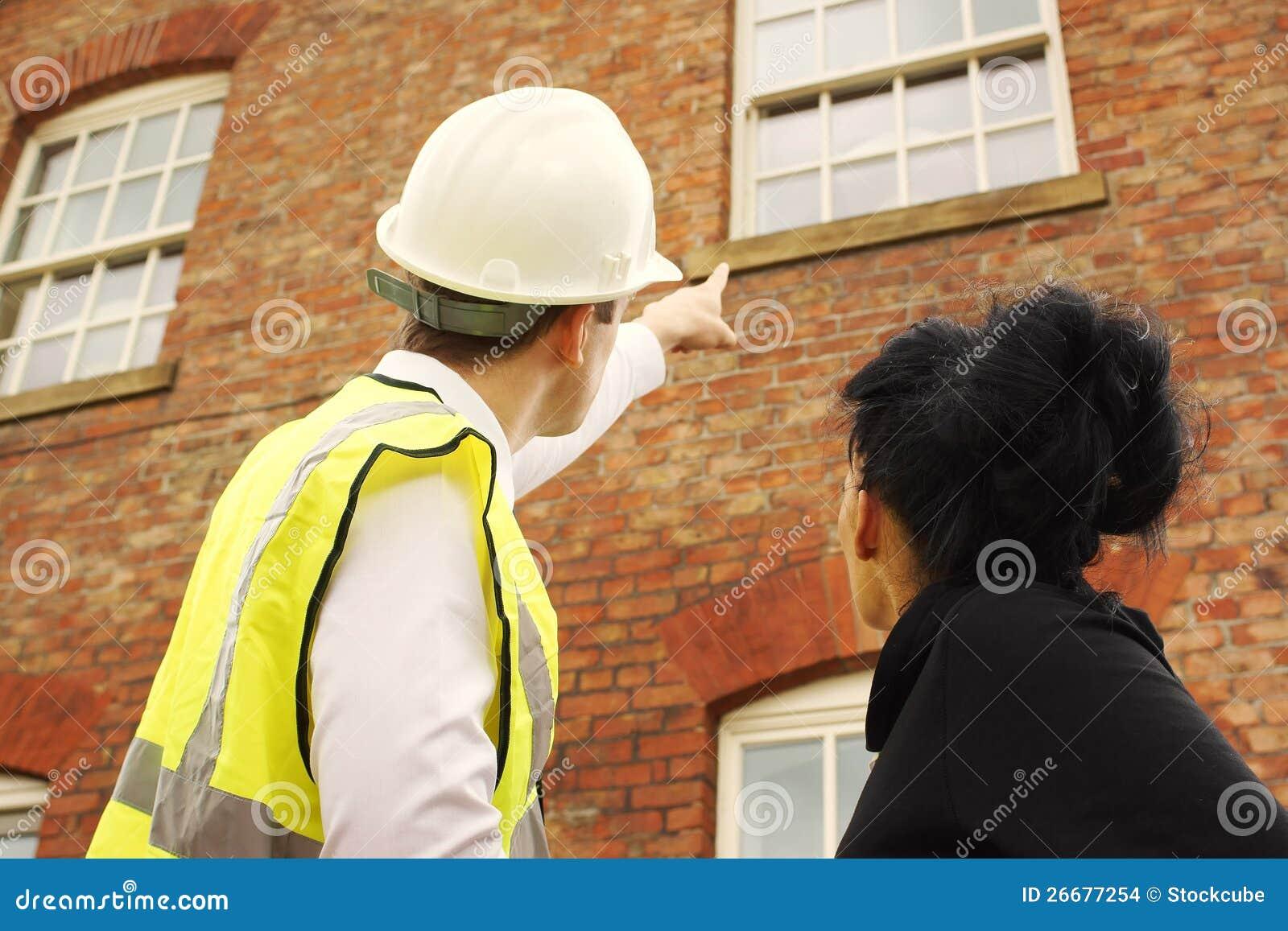 Surveyor builder homeowner looking at property