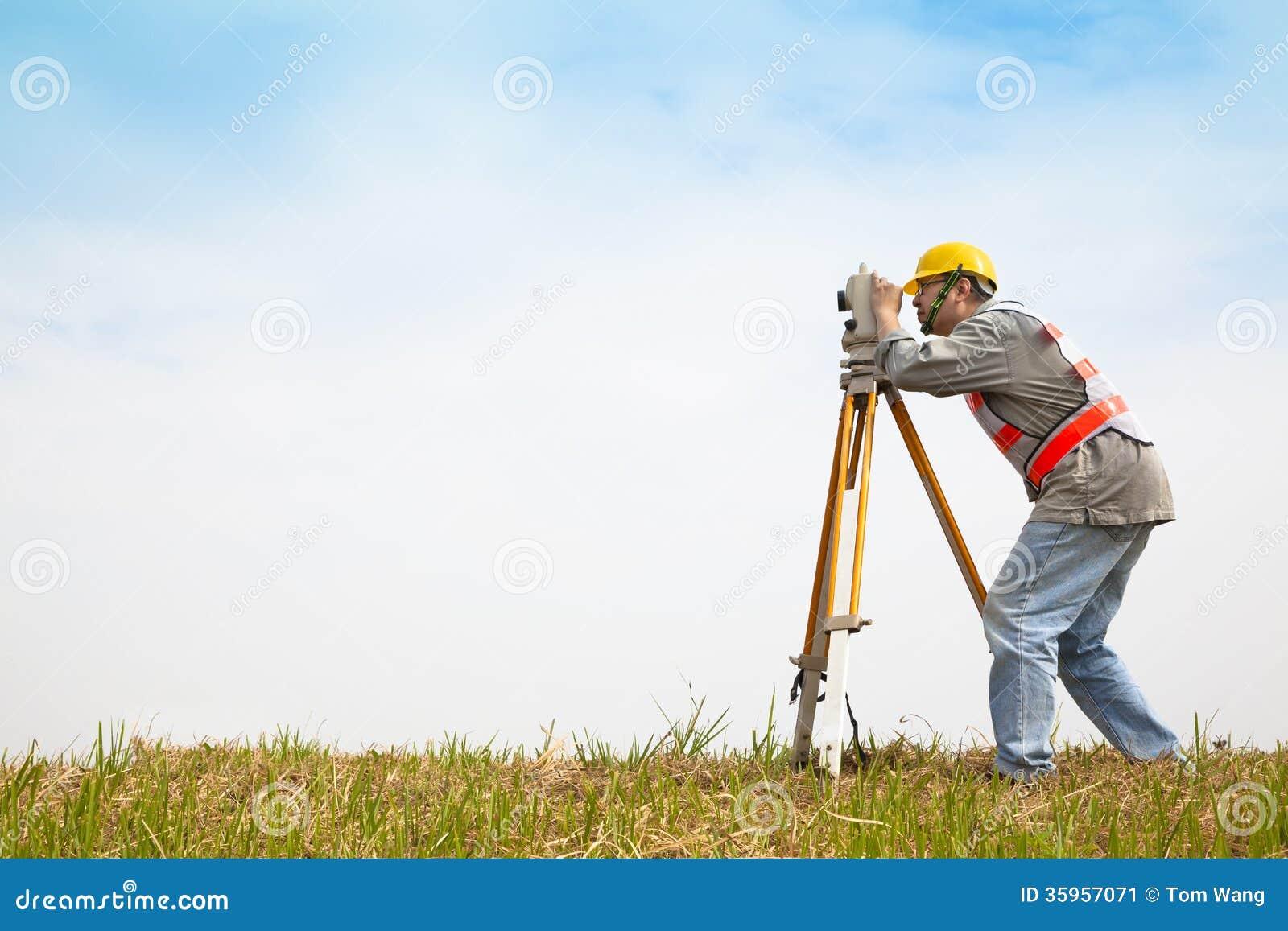 Surveyor engineer making measure